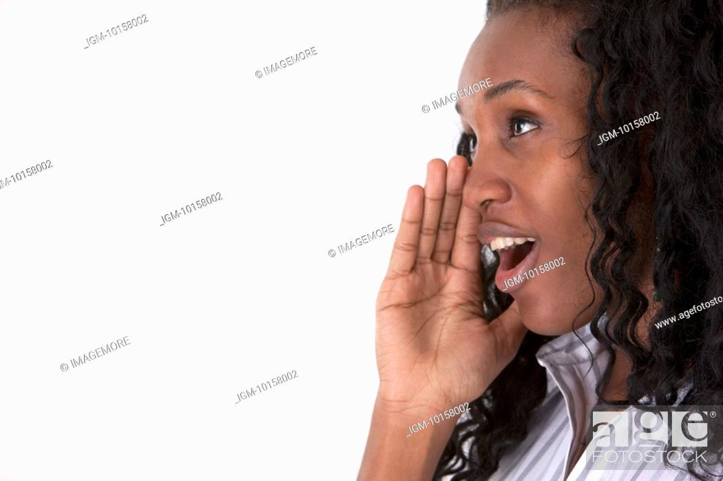 Stock Photo: Young woman looking away and shouting.