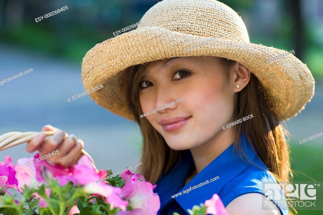 Stock Photo: Smiling pretty woman gardener.