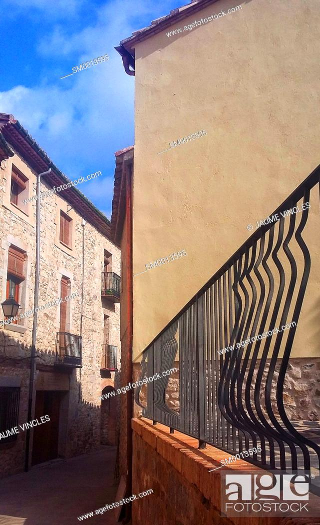 Stock Photo: Sensation of depth and twist, in a narrow street of a town of Girona.