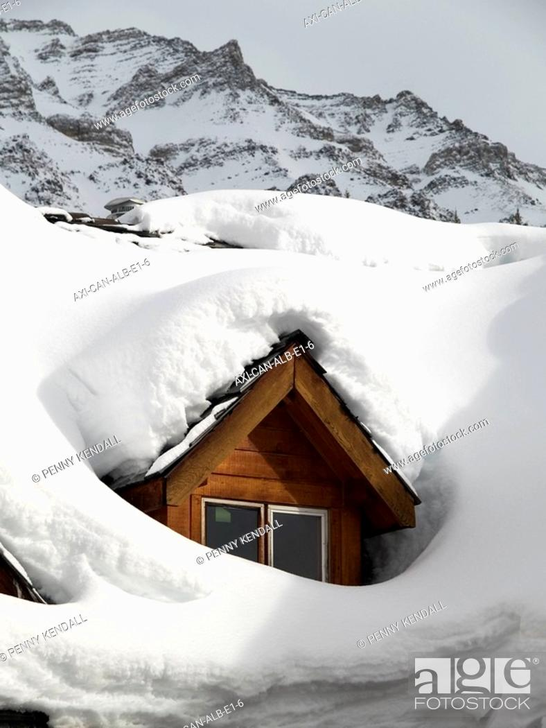 Stock Photo: Snow covered dormer window in a chalet.