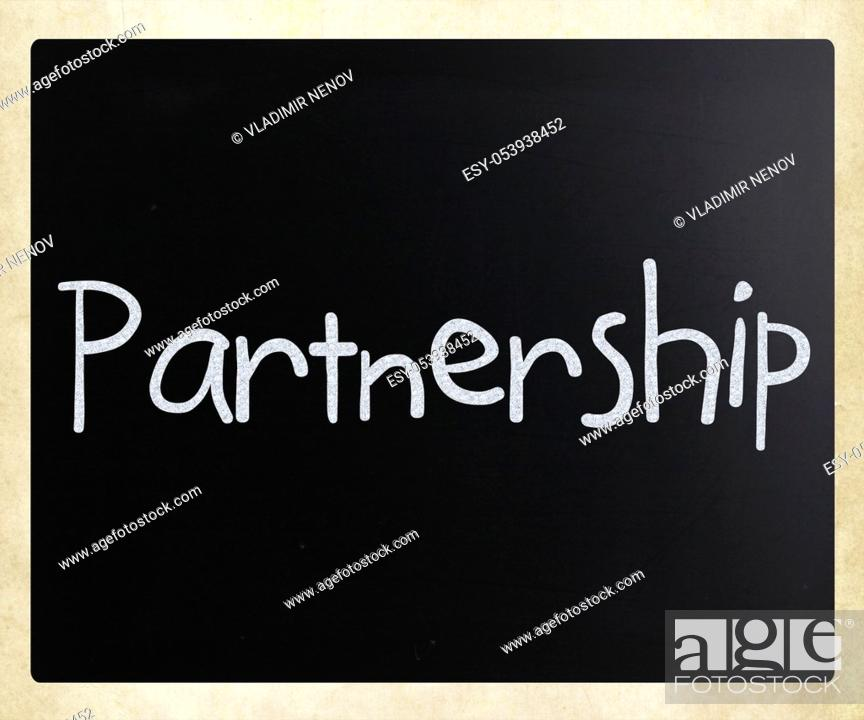 Stock Photo: The word 'Partnership' handwritten with white chalk on a blackboard.