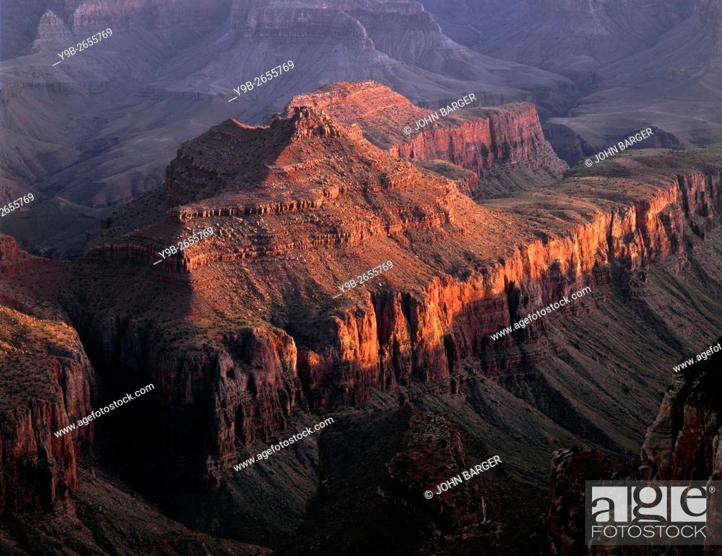 Stock Photo: USA, Arizona, Grand Canyon National Park, North Rim, Setting sun warms Krishna Shrine, view south from Cape Royal.