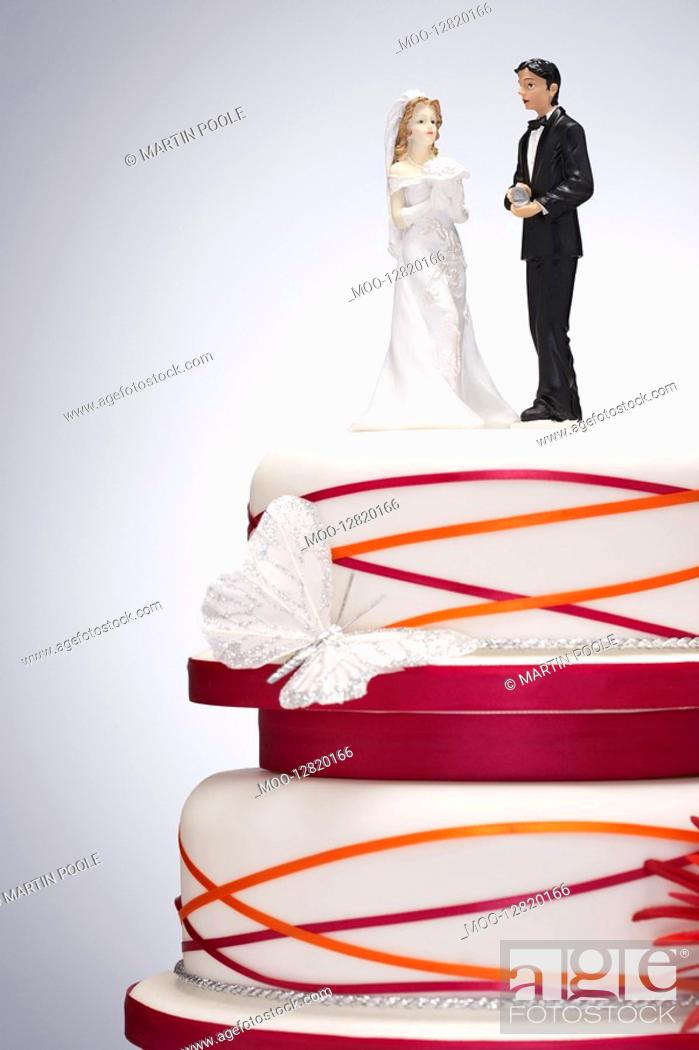 Stock Photo: Wedding Cake with Bride and Groom Figurines.