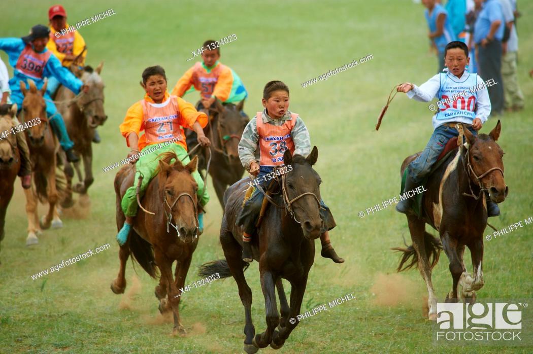 Stock Photo: Mongolia, Bulgan province, horse race at the Naadam festival.