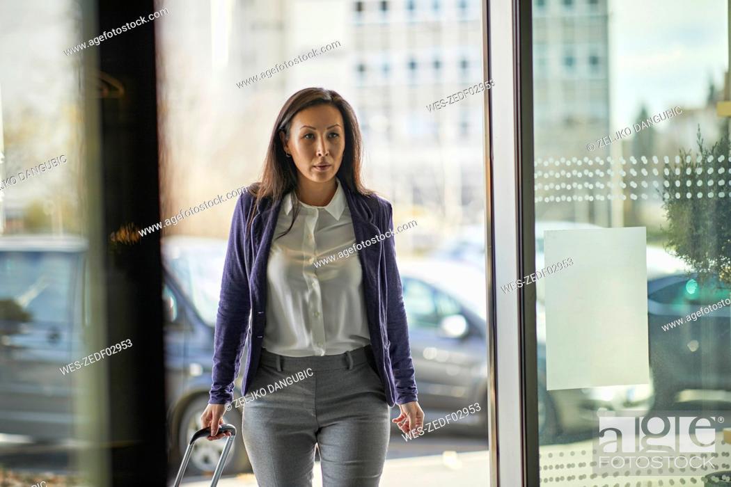 Stock Photo: Businesswoman entering hotel.