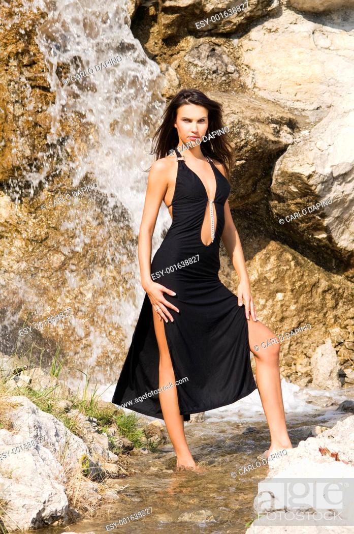 Stock Photo: waterfall and black dress.
