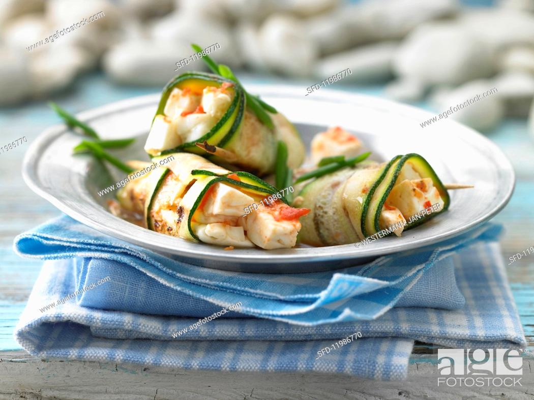 Stock Photo: Grilled courgette rolls with sheep's cheese.