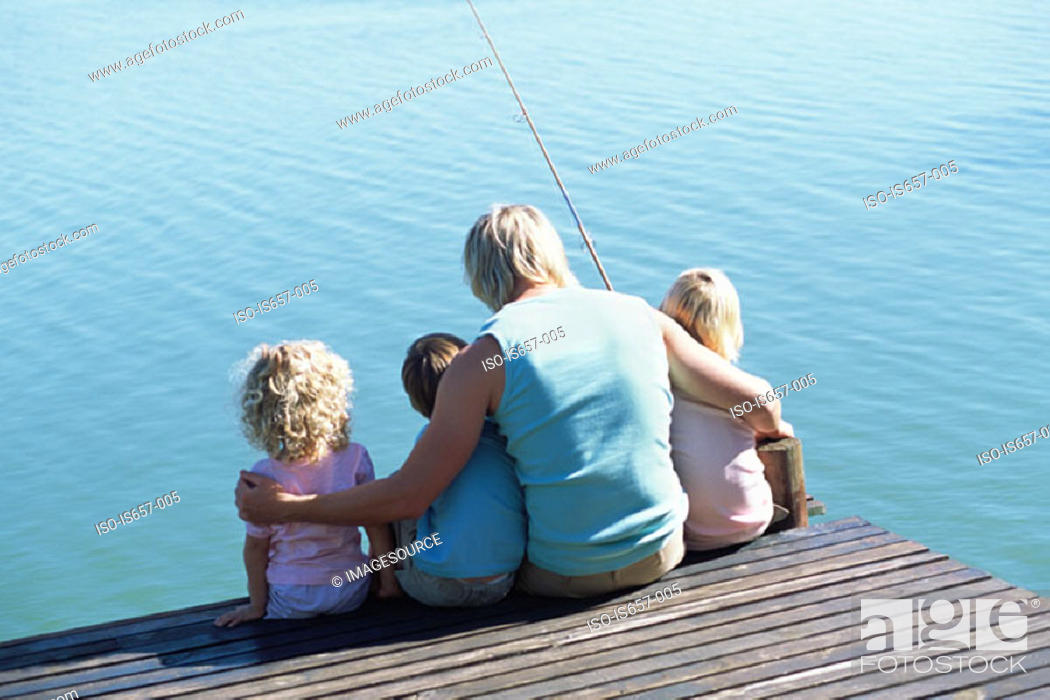 Stock Photo: Father with children on jetty.