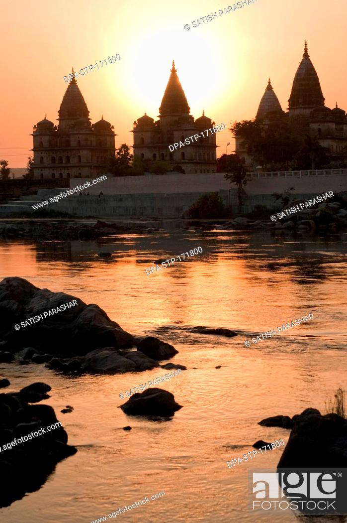 Stock Photo: Sunset with cenotaphs at bank of river Betwa , Orchha , Tikamgarh , Madhya Pradesh , India.
