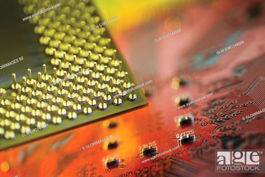 Stock Photo: Close-up of a CPU on a mother board.