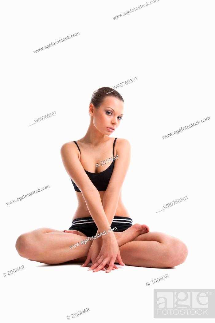 Stock Photo: happy young woman sit prepare for fitness.