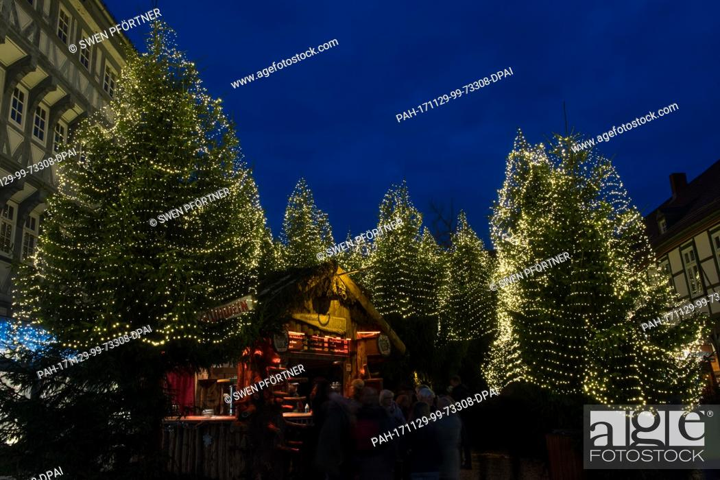 Stock Photo: Visitors stand in front of the 'Christmas forest' at the Christmas market in Goslar, Germany, 29 November 2017. The Christmas market in Goslar is open from 29.