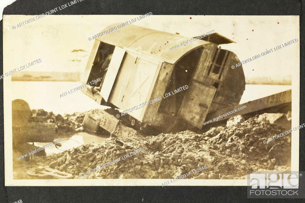Stock Photo: Photograph - A.T. Harman & Sons, Destroyed Excavator Near a River, Victoria, circa 1923, One of five black and white photographs attached to an album page.