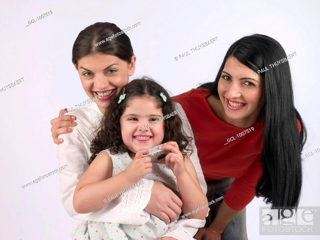 Stock Photo: Two women and a child holding a camera.
