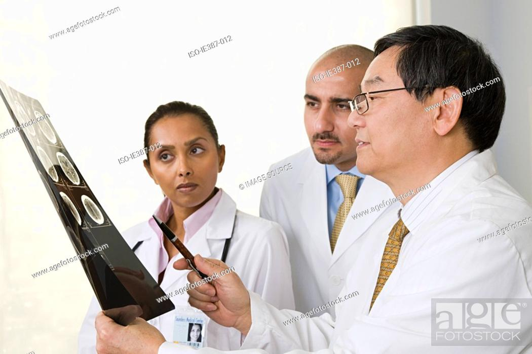 Stock Photo: Doctors looking at an xray.