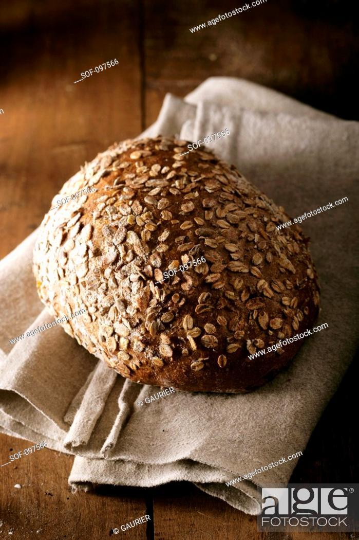Stock Photo: Oat bread loaf on a tea towel.