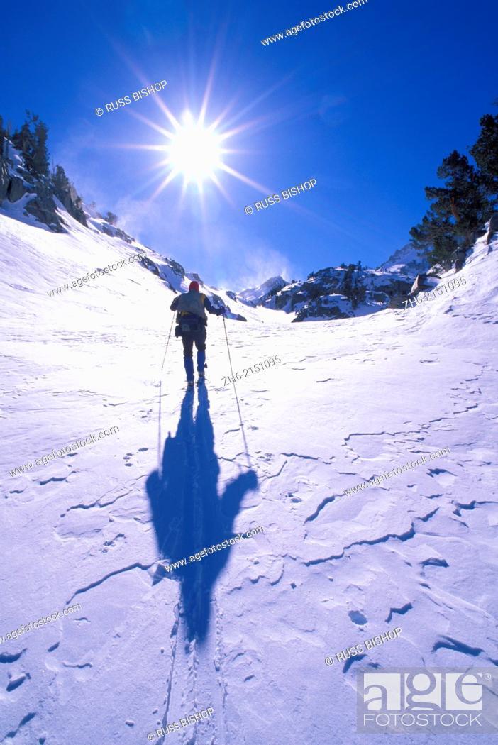 Stock Photo: Backcountry skier crossing wind blown snow near Treasure Lakes, John Muir Wilderness, California USA.
