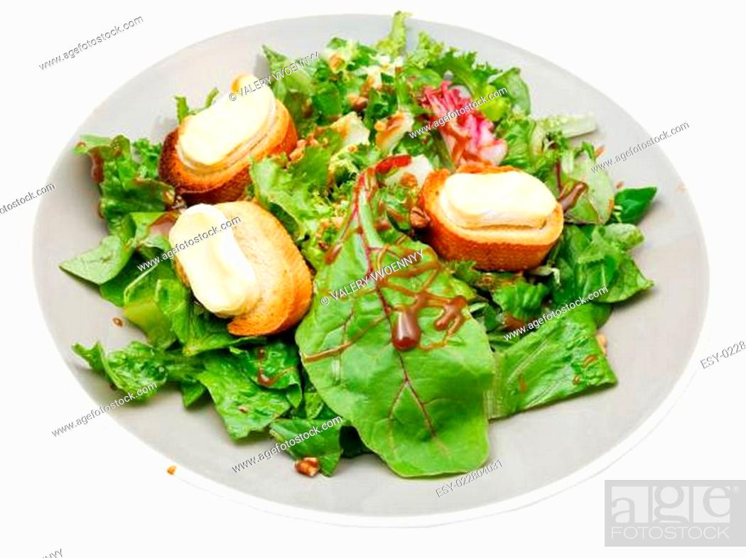 Stock Photo: green salad with goat cheese on plate.