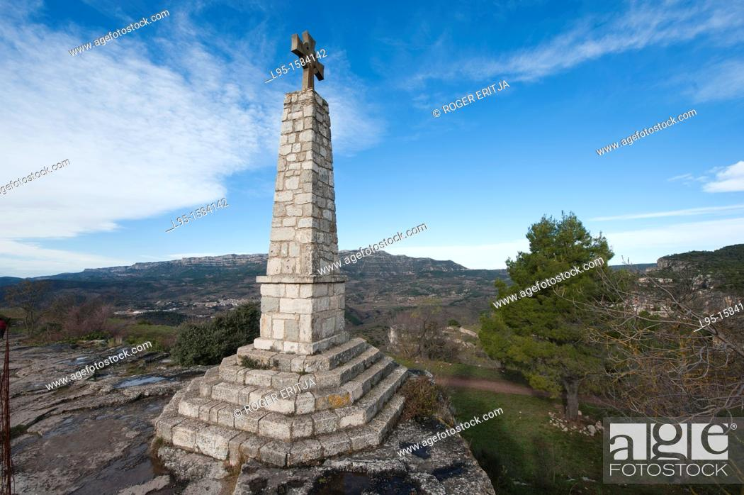 Stock Photo: Stone cross at the limits of the small rock-perched village of Siurana, Tarragona province, Catalonia, Spain.