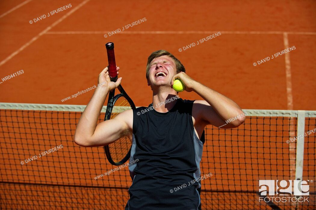 Stock Photo: A tennis player celebrates winning the game.