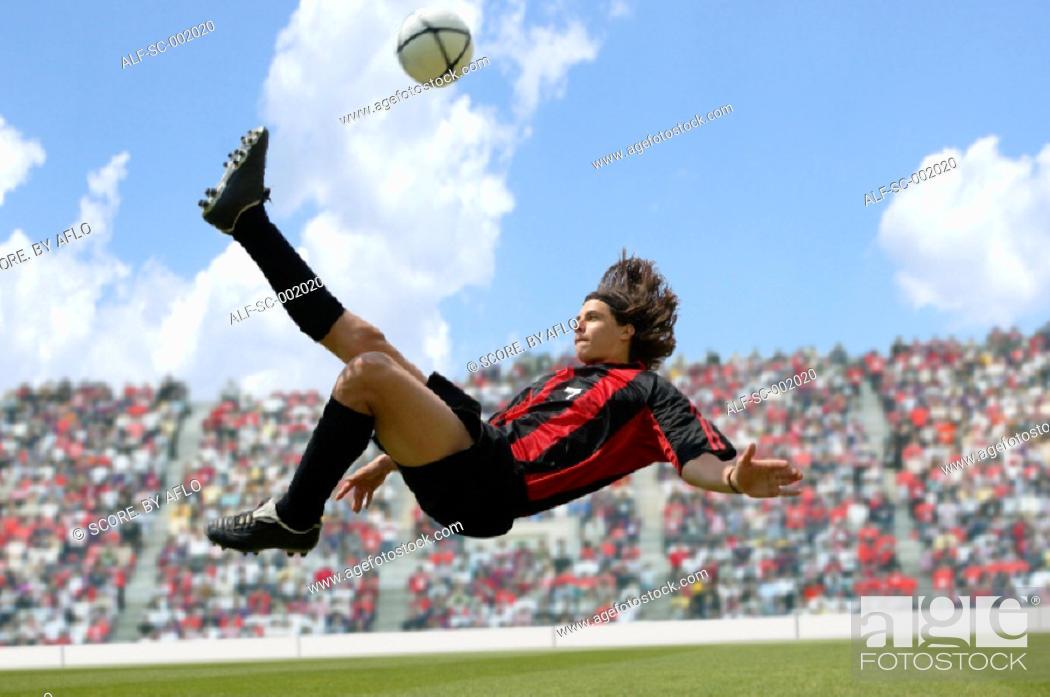 Stock Photo: Soccer player doing scissor-kick.