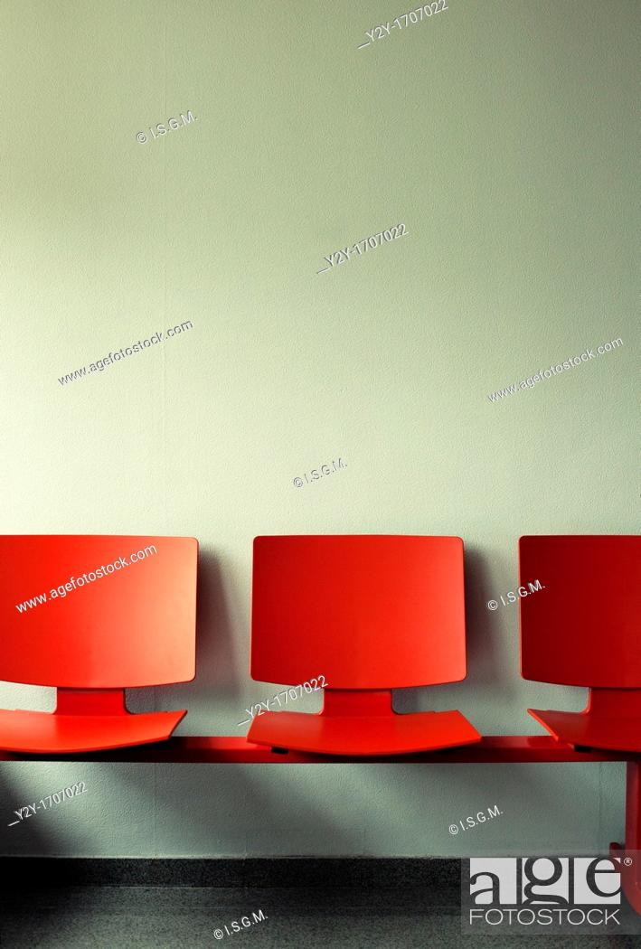 Stock Photo: Waiting room with red chairs.