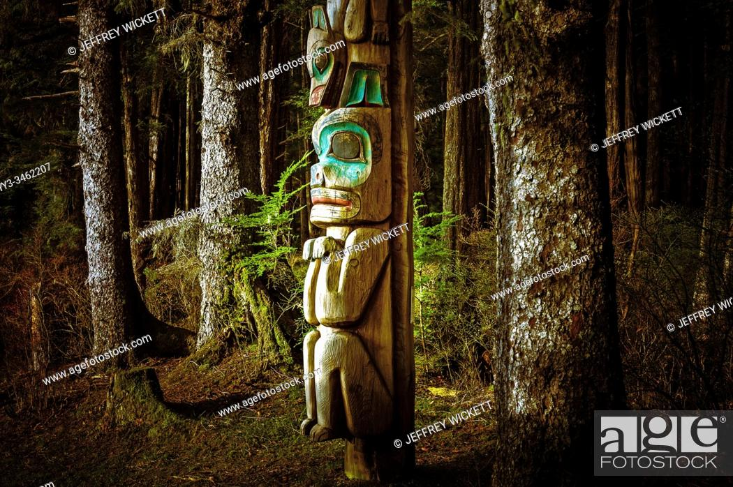 Stock Photo: Totem pole beside tourist trail in Sitka National Historical Park in Sitka, Alaska, USA.