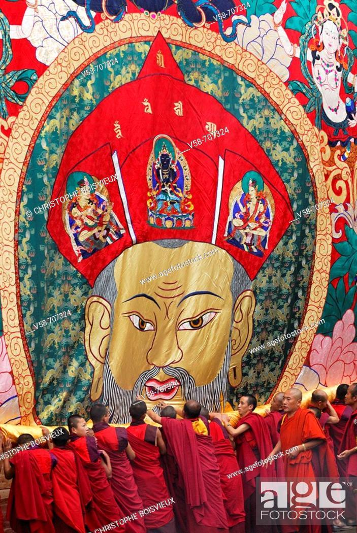Stock Photo: Monks unrolling a huge thangka or thongdrel representing the shabdrung, Bhutan's greatest ruler, punakha tsechu festival, punakha, Bhutan.