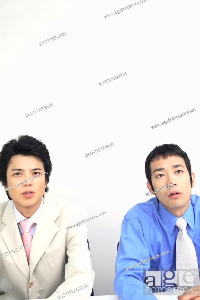 Stock Photo: Portrait of businessmen.