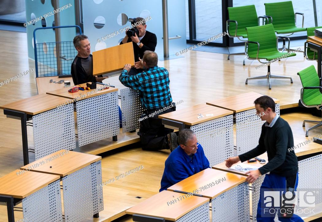 Workers Change The Seating Arrangement Of The Plenary Hall At The