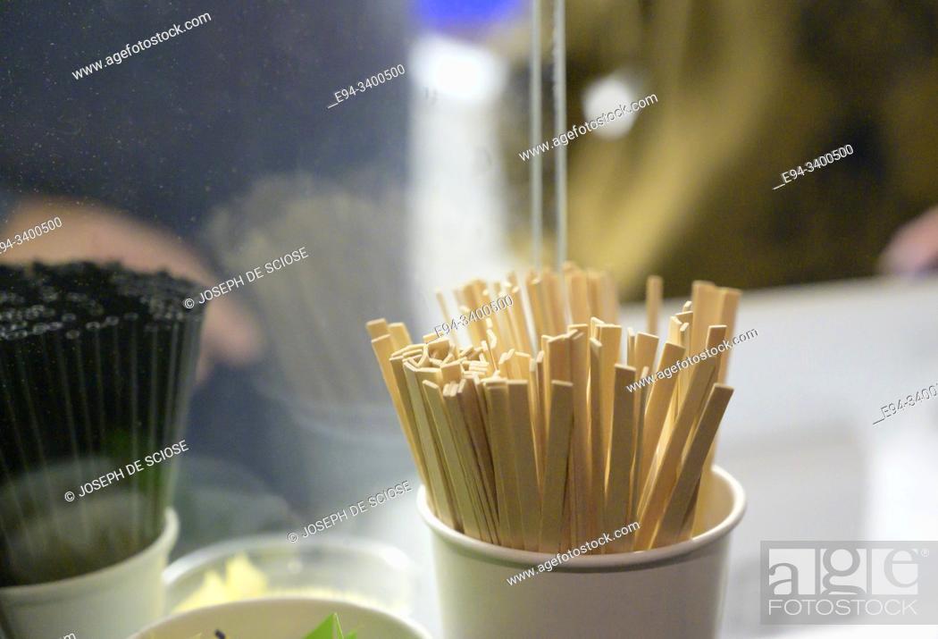 Photo de stock: Coffee stir sticks in a cup.
