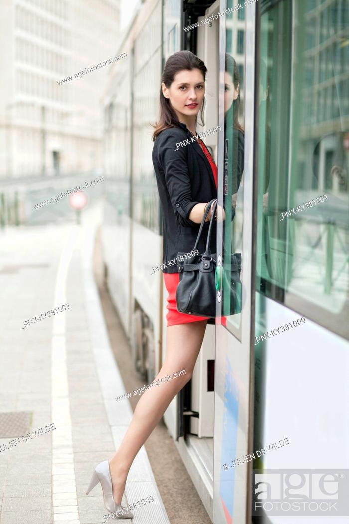 Stock Photo: Woman boarding a tram.