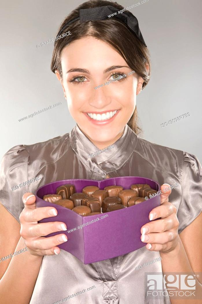 Stock Photo: Woman holding a box of chocolates.
