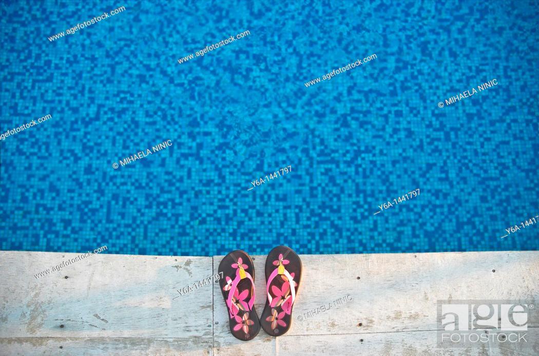 Stock Photo: Flip-flops at poolside.