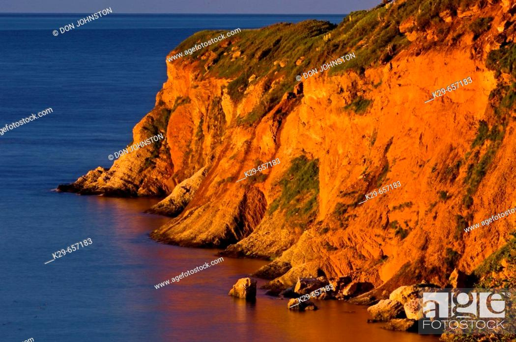Stock Photo: Dawn light on cliffs at Cap Canon. Gaspésie, Quebec, Canada.
