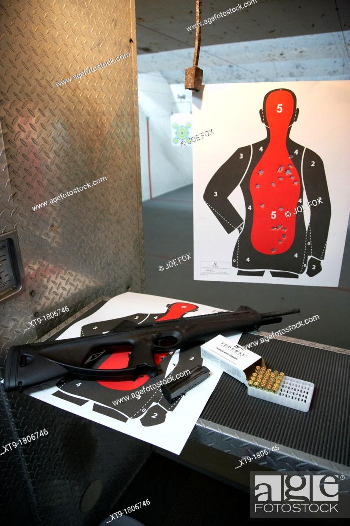 Stock Photo: beretta cx4 storm 9mm semi automatic rifle at a gun range in florida usa.