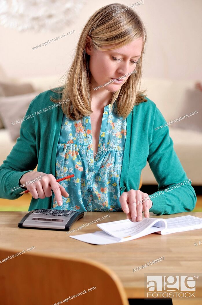 Stock Photo: Woman with pocket calculator and statements of account.