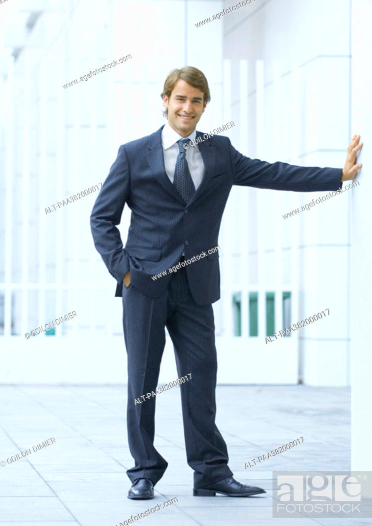 Stock Photo: Businessman standing with hand in pocket, full length.