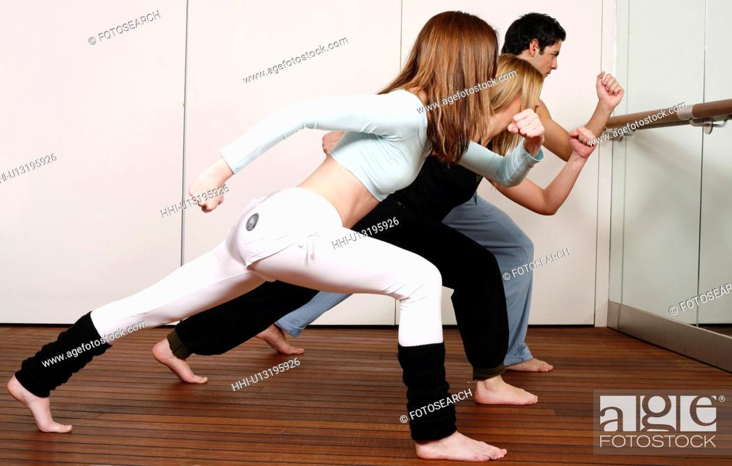 Stock Photo: Students learning a basic Capoeira move.