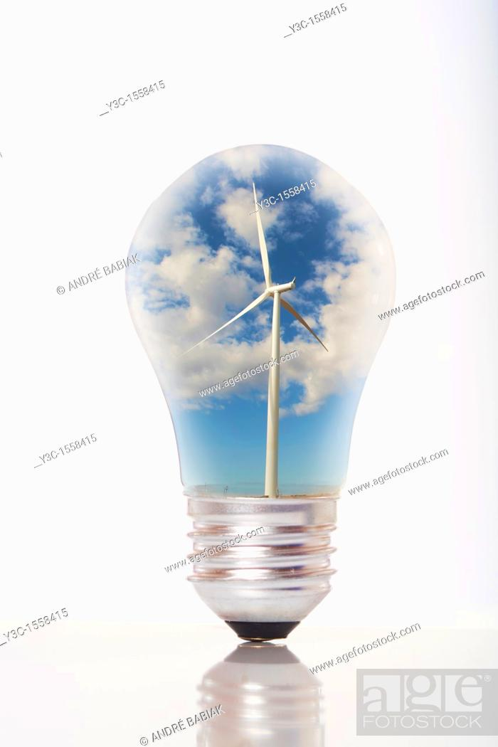 Stock Photo: Light bulb with wind turbine generator inside as symbol for green energy.