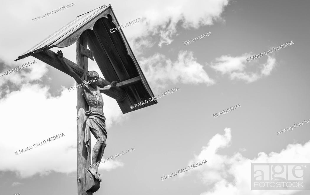 Stock Photo: A 100 years old Crucifix, made of wood, tipical of Dolomity Region in North-East of Italy.