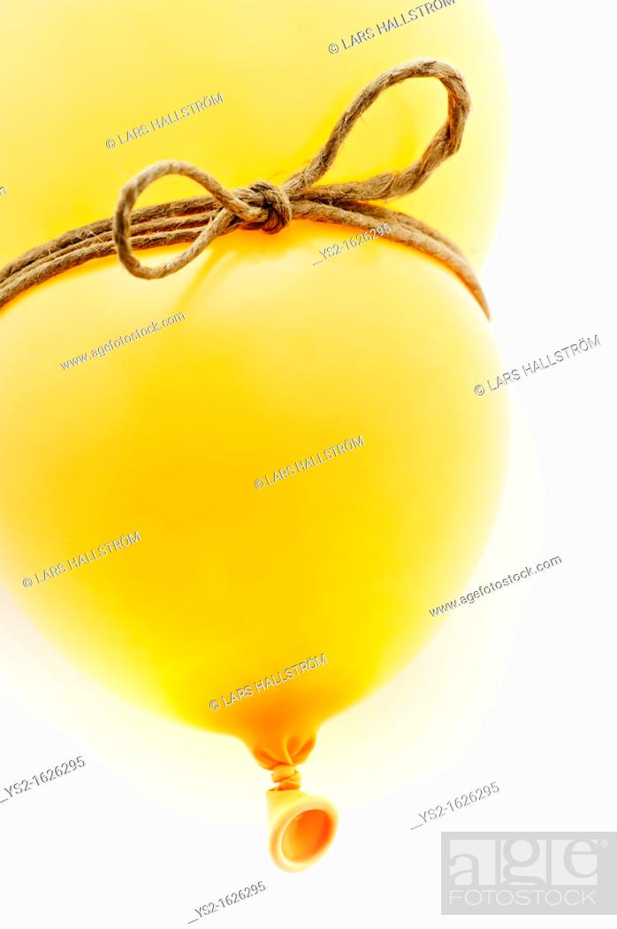 Stock Photo: Yellow balloon with a string.