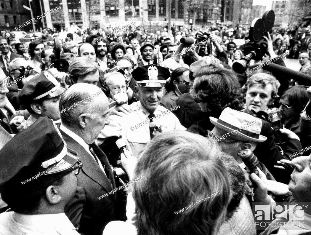Stock Photo: Former Atty. Gen. John Mitchell was escorted by police from New York's Federal Court. April 24, 1973. He testified before a grand jury about a $200.