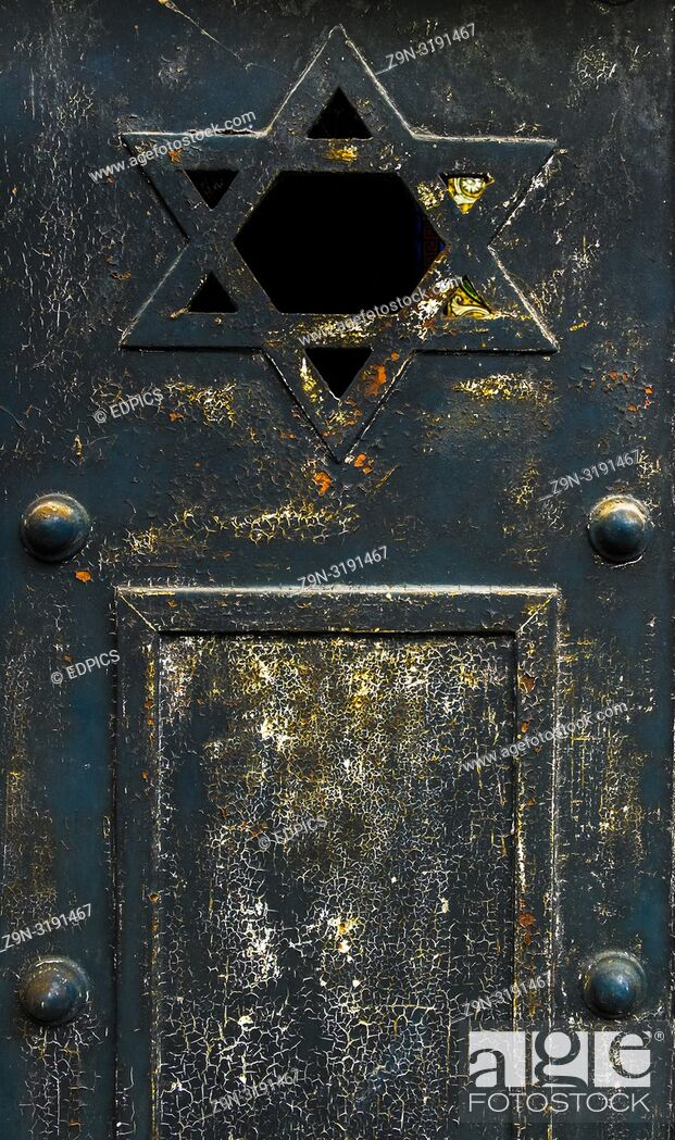 Stock Photo: detail of historic metal door showing the star of david, paris, ile de france, france.