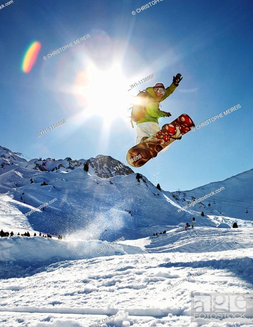 Stock Photo: Snowboarder jumping right in.