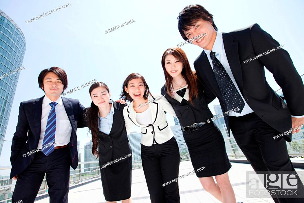 Stock Photo: Businesspeople with arms around each other.