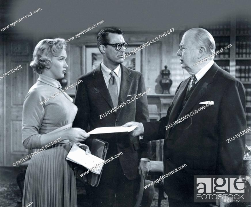 Stock Photo: RELEASED: Sep 05, 1952 - Original Film Title: Monkey Business. PICTURED: MARILYN MONROE as Miss Lois Laurel, CARY GRANT as Dr.