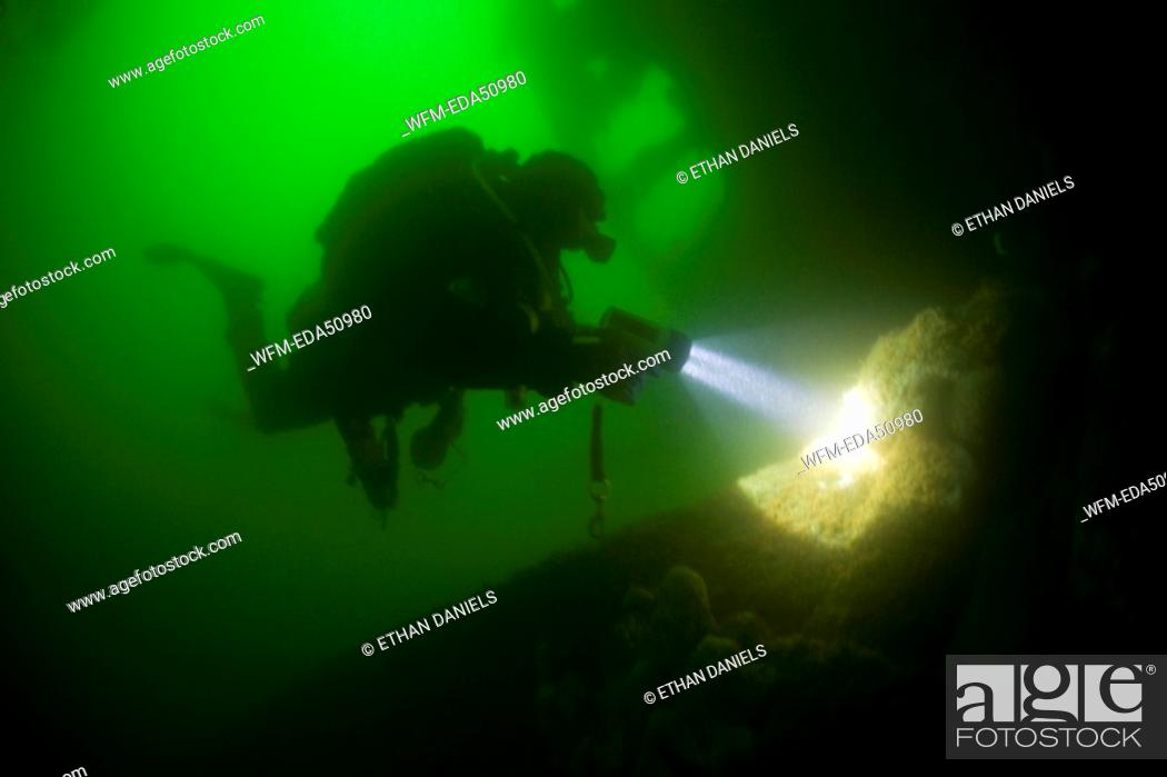 Stock Photo: Diver at Nauset Barges Wreck, Cape Cod, Massachusetts, USA.