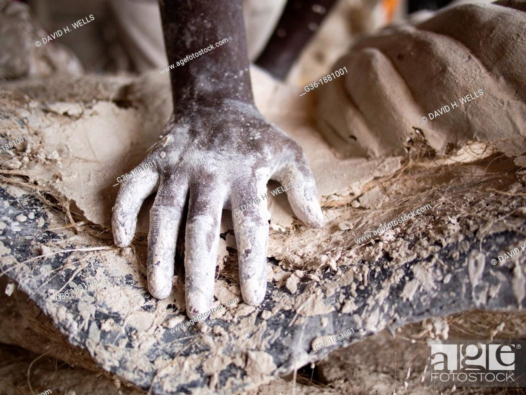 Stock Photo: A worker's hand covered with plaster in Ahmedabad, India.