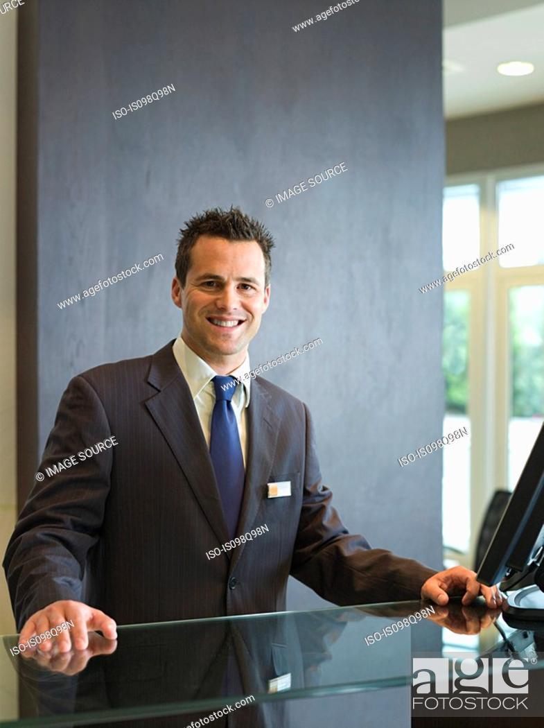 Stock Photo: Man at a hotel reception.